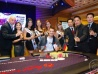 Malzanini celebrating his win with (L-R) APT CEO Jeff Mann, APT Event and Promotions Manager Monique De Jesus, the APT Girls, RWM Gaming Operations Director Arturo Basa, APT TD Lloyd Fontillas and RWM Poker Room Manager Roderick Go
